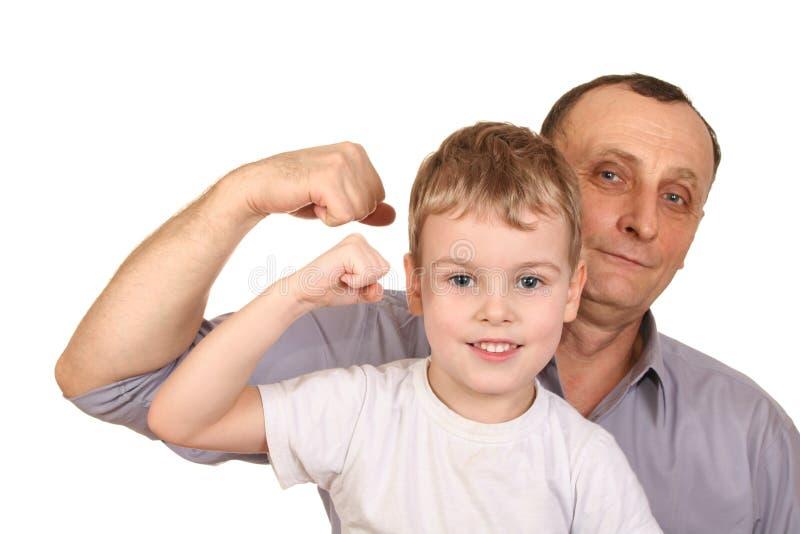 bicepsbarnfarfar arkivfoto