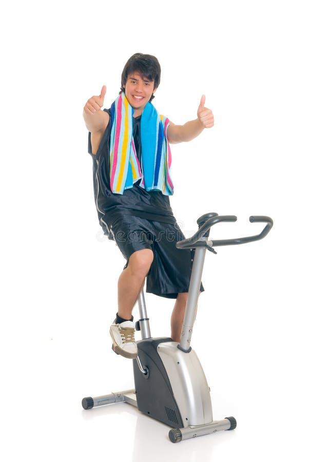 Bici de la aptitud del adolescente imagen de archivo libre de regalías