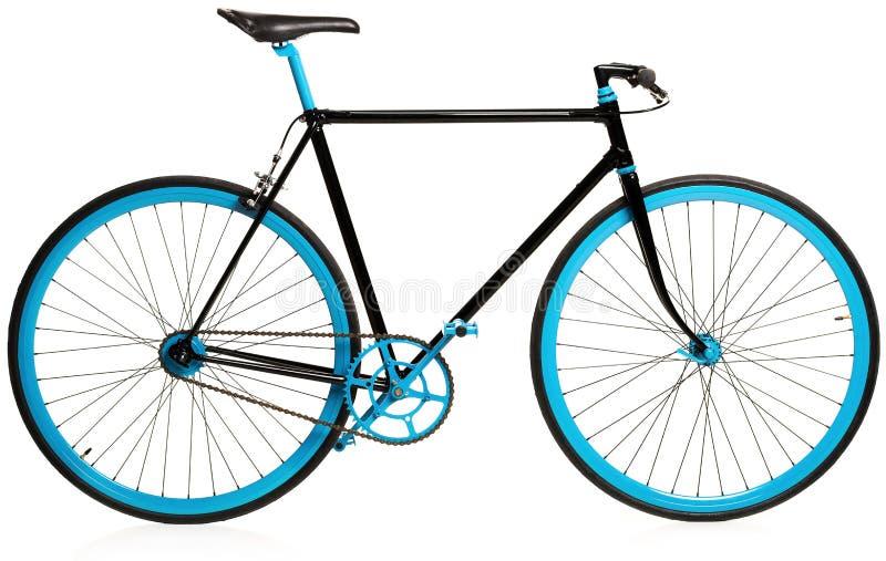 Bicicleta azul à moda isolada no branco fotografia de stock royalty free