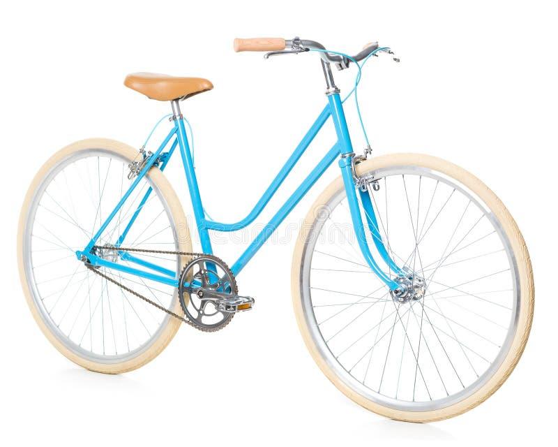 A bicicleta azul das mulheres à moda isolada no branco foto de stock