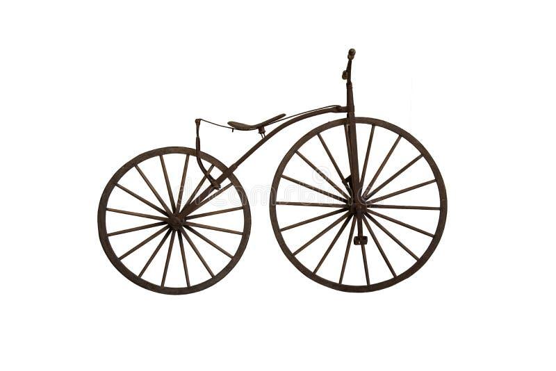 Bicicleta de madera antigua en el fondo blanco fotografía de archivo libre de regalías