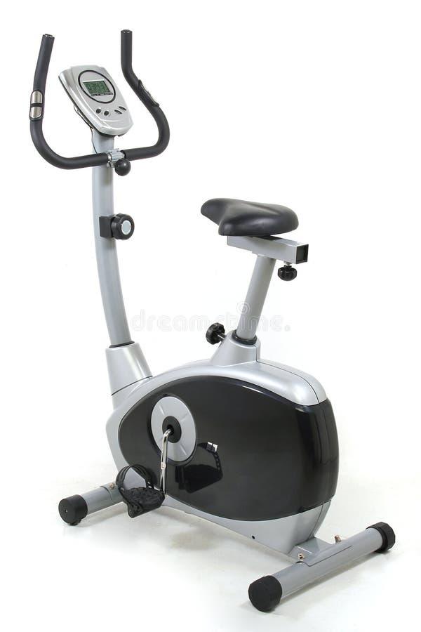 Bicicleta estacionária. Máquina da ginástica imagem de stock royalty free