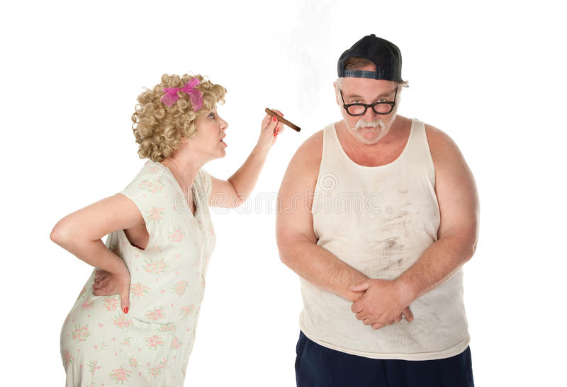 Bickering Couple. Hillbilly housewife berating her husband stock image