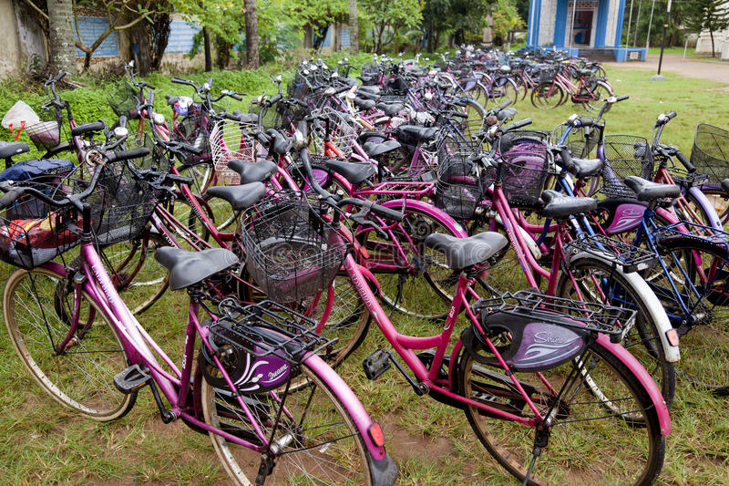 Bicycle. Cochin, India-September 04, 2012. several bicycles parked at the exit of a school getting wet in the monsoon stock image