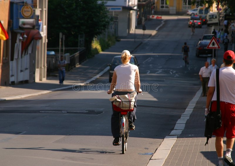 Bicycle. Woman on a bicycle royalty free stock photography