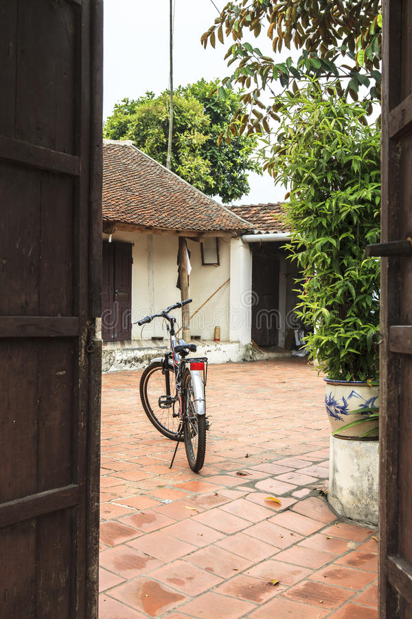A Bicycle in ancient village in Hanoi. This photo was taken in June at Hanoi, capital of Vietnam. The ancient village has a history of about 1,200 years with royalty free stock image
