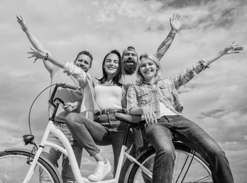 Bicycle as part of life. Cycling modernity and national culture. Group friends hang out with bicycle. Share bike live. Eco friendly. Company stylish young royalty free stock images