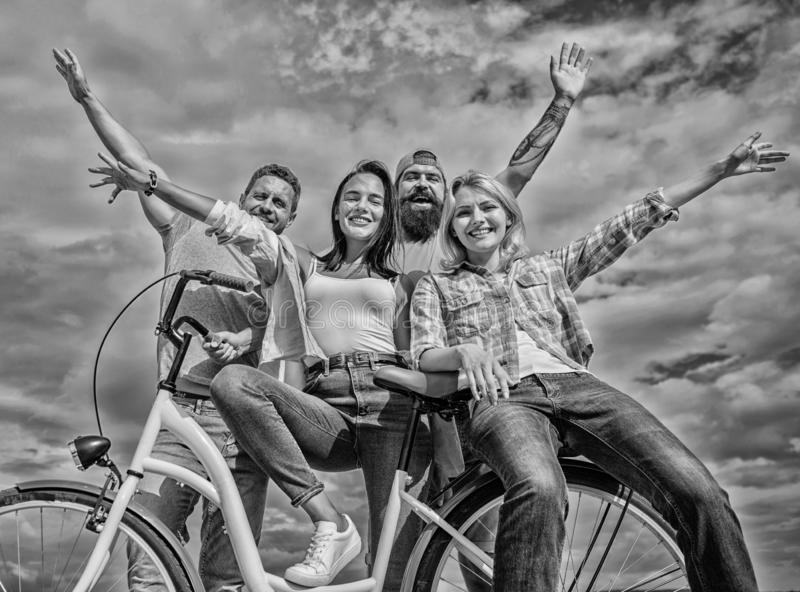 Bicycle as part of life. Cycling modernity and national culture. Group friends hang out with bicycle. Share bike live royalty free stock images
