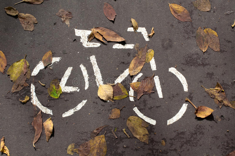 A bicycle is on the asphalt. stock image
