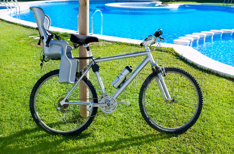 Download Bicycle With Baby Seat In Grass Pool Outdoor Stock Photography - Image: 23307622