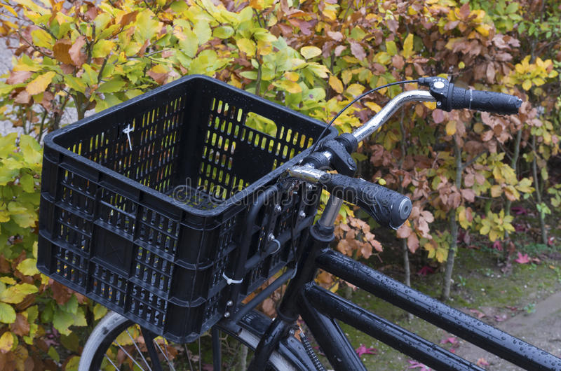 Bicycle with basket. Basket on a black bicycle stock photo