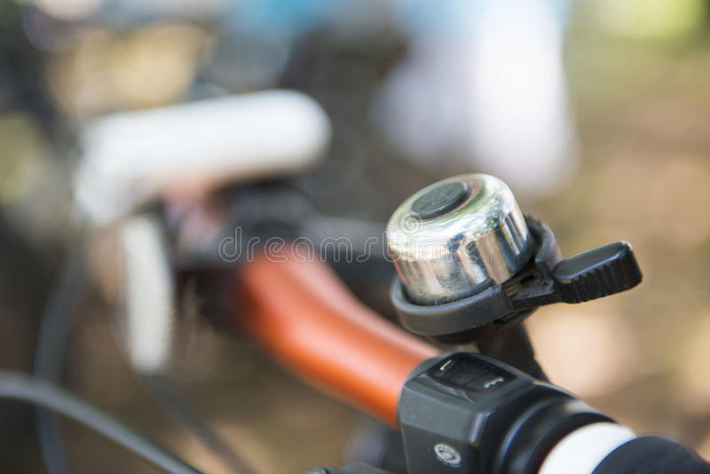 Bicycle bell on handle bar royalty free stock photo