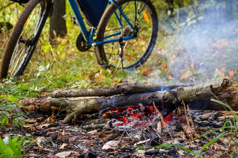 Bicycle and bonfire, bike trip in nature royalty free stock image