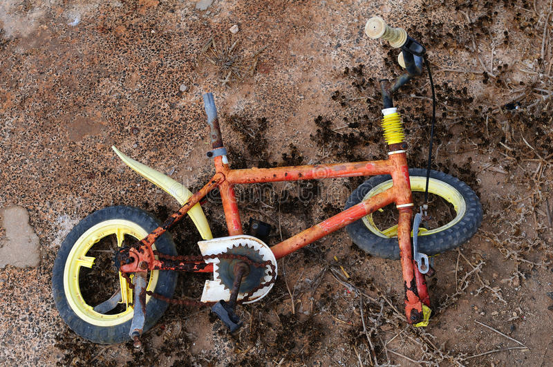 Bicycle broken. Close up photo of a bicycle totally broken in the floor royalty free stock photography