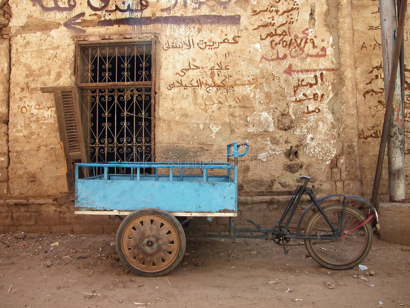 Bicycle cart by old wall. In Egypt stock images