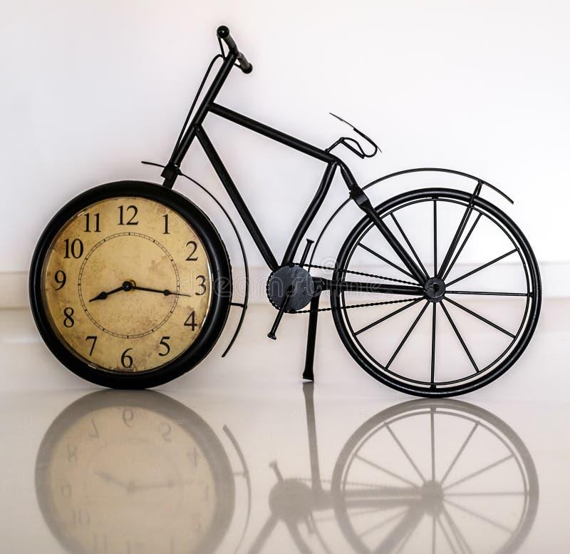 Bicycle clock decoration. On white background stock image