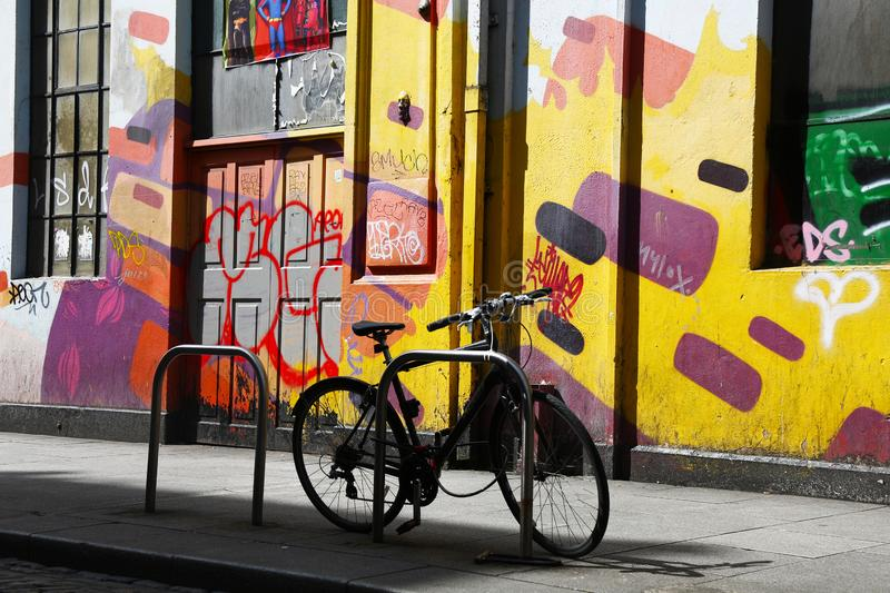 Bicycle on a coloured wall. In Dublin royalty free stock photo