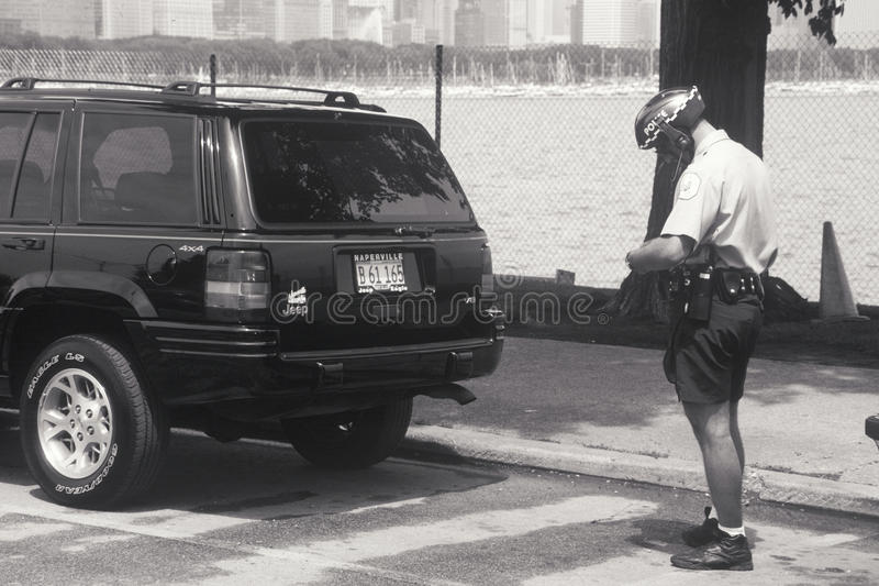 Download Bicycle cop writing ticket editorial stock photo. Image of america - 26270133