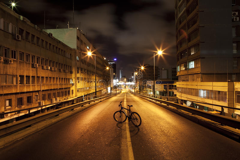 Bicycle on Dark Road stock image