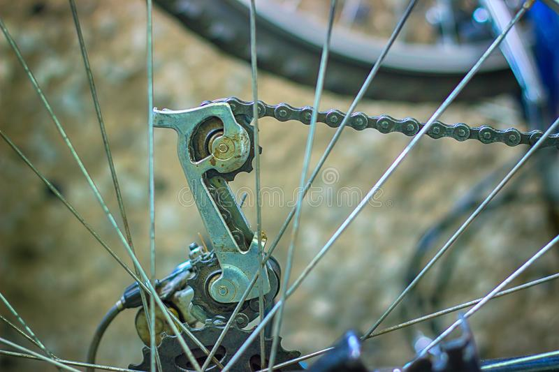 Bicycle detail of rear wheel with chain and sprocket royalty free stock photos