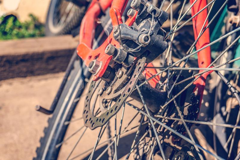 Bicycle disc brakes close up. Red bike parked.  royalty free stock image