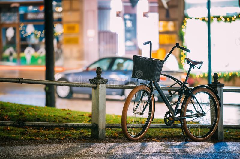 Bicycle Equipped Basket Parked In European City Street In Night stock photography