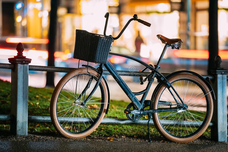 Bicycle Equipped Basket Parked In European City Street In Night stock photos