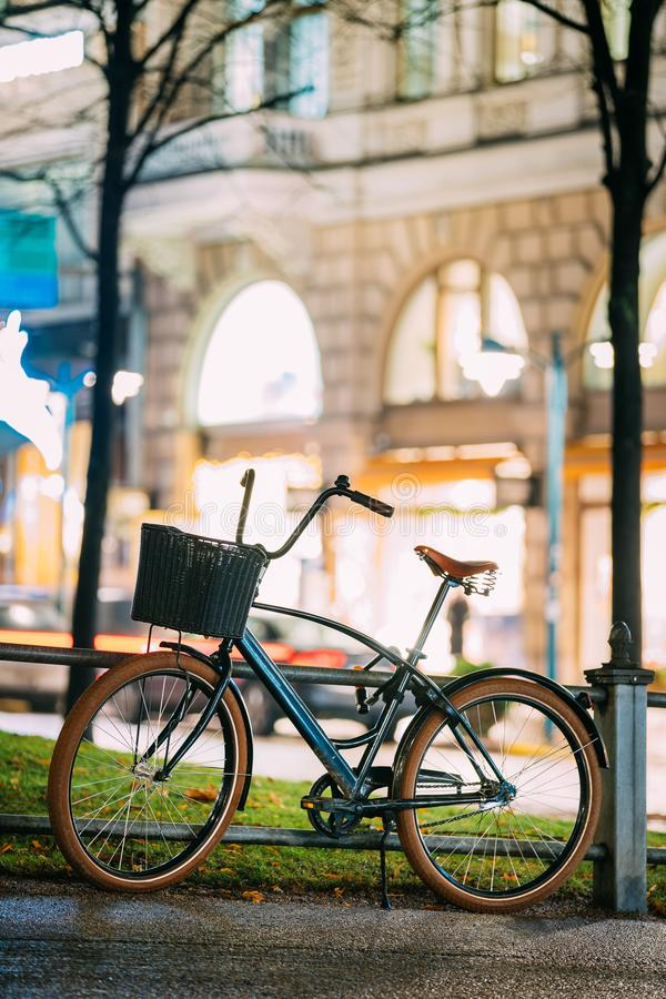Bicycle Equipped Basket Parked In European City Street In Night royalty free stock photo