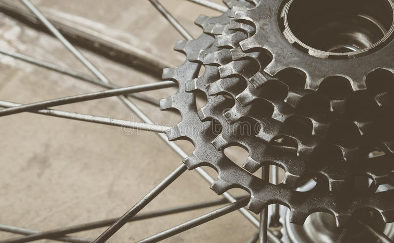 Bicycle gear cassette. Part of rusty bicycle gear cassette (selective focus), vintage effect royalty free stock photography