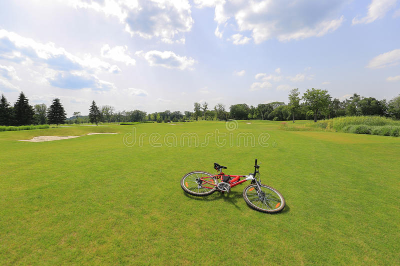 Bicycle on the grass. Mountain biking on the grass royalty free stock photo