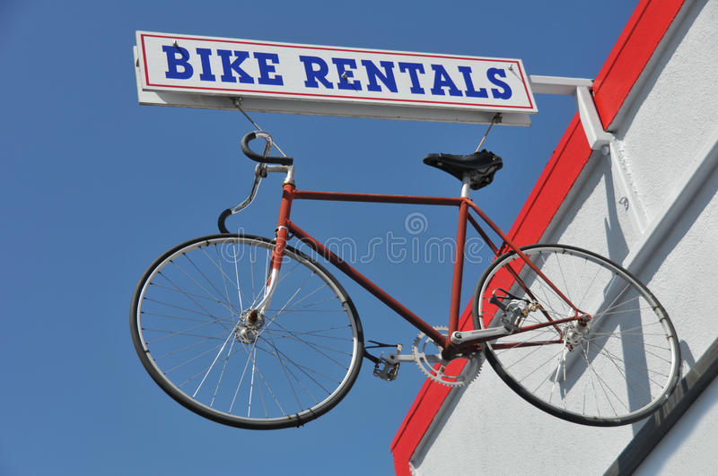 Download Bicycle Hanges From A Bike Rentals Sign Outside Stock Image - Image: 24128877