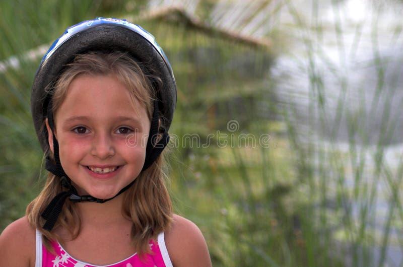 Bicycle Helmet. Happy Child in Bicycle Helmet royalty free stock image