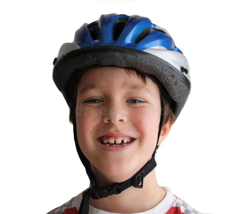 Bicycle helmet. Happy young boy wearing a bicycle helmet isolated on white stock image