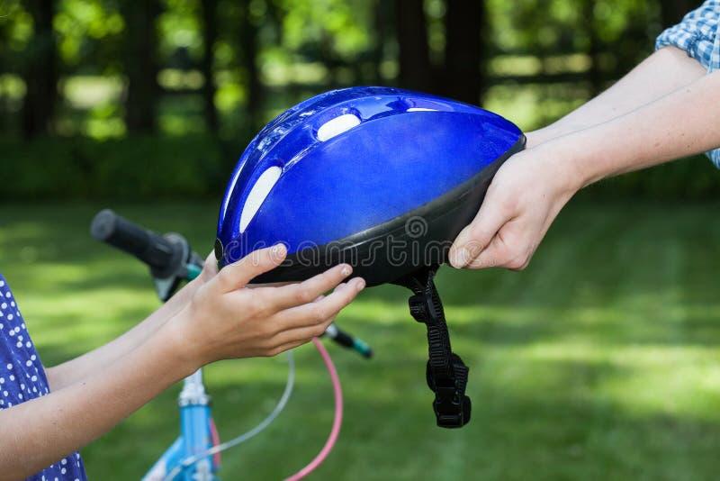 Bicycle helmet. Close up of bicycle helmet held by two people royalty free stock photos