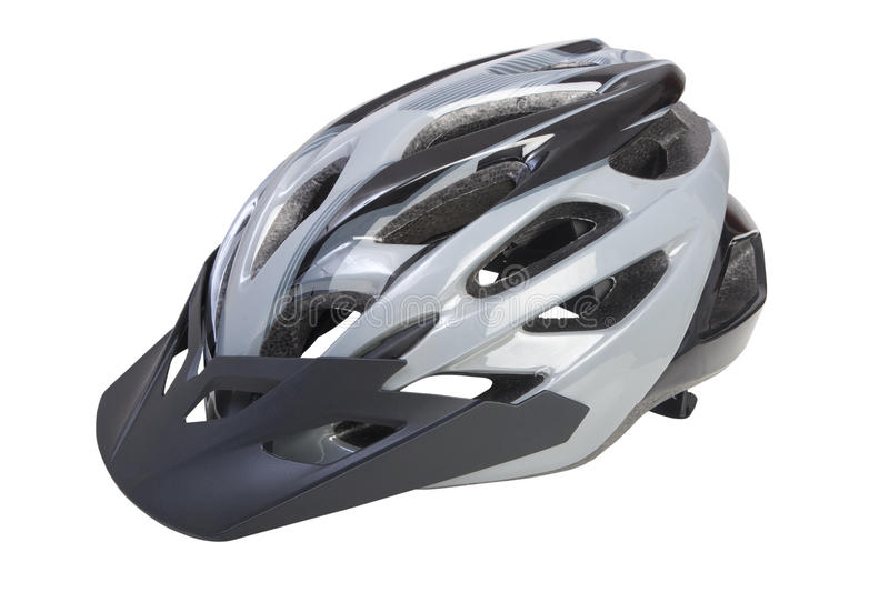 Bicycle helmet with visor on white background. PNG available. A bicycle helmet with visor on white background. The helmet has a gray and black antracide royalty free stock photos