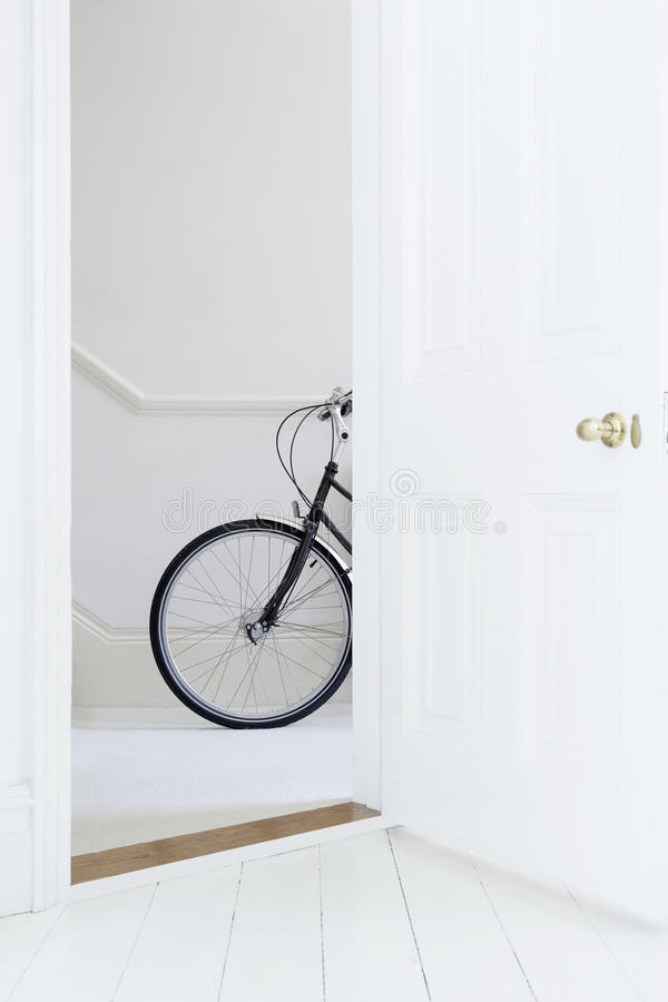 Bicycle inside a aprtment stock photos