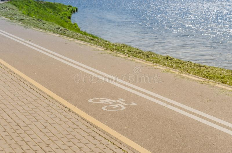 Bicycle lane for exercise surround with along sea/bicycle lane for exercise surround with along sea in sunny day. Bicycle lane for exercise surround with along royalty free stock photos
