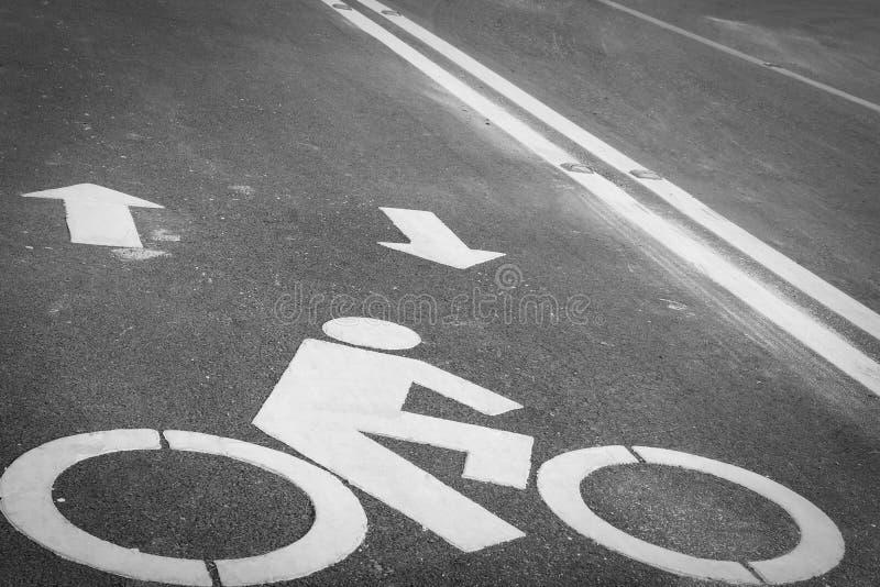 Bicycle lane or path, icon symbol on asphalt road. Bicycle lane or path , icon symbol on asphalt road royalty free stock image