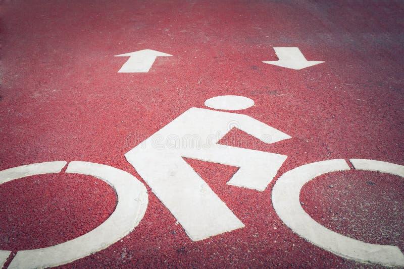 Bicycle lane or path, icon symbol on asphalt road. Bicycle lane or path , icon symbol on asphalt road stock photos