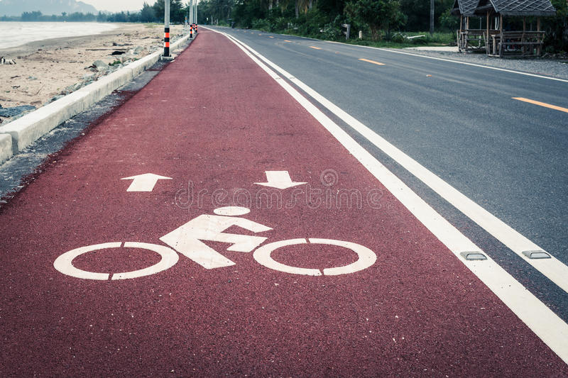 Bicycle lane or path, icon symbol on red asphalt road. Bicycle lane or path , icon symbol on red asphalt road royalty free stock photography
