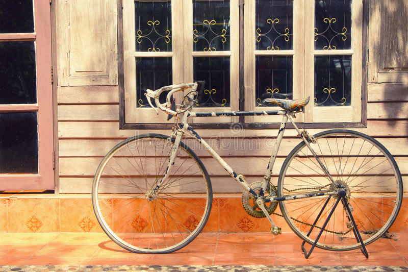 Bicycle leaning against house wall stock photography