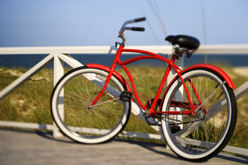 Bicycle leaning against rail royalty free stock photo