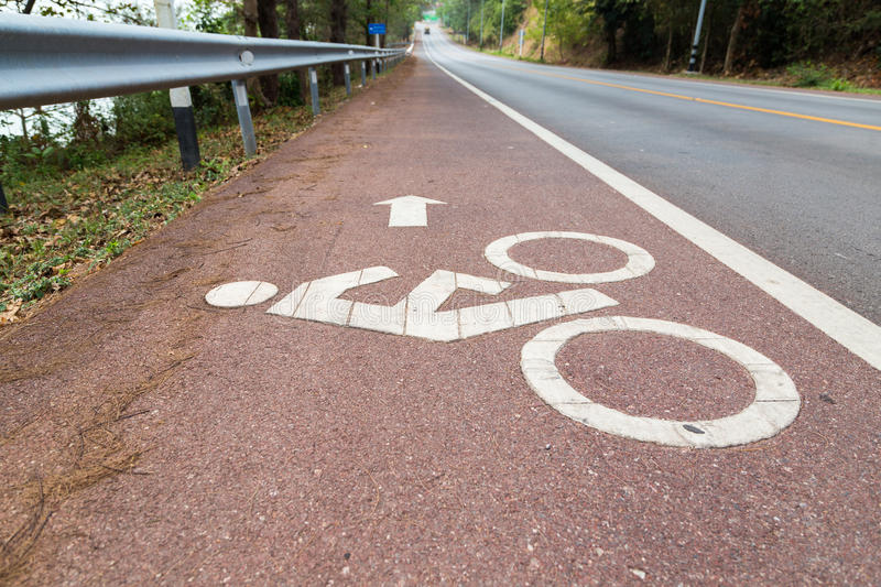 Bicycle lens symbol on the road. stock image