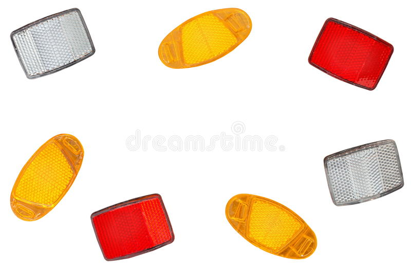 Bicycle light reflectors. A scattering of bicycle light reflectors isolated on a white background stock photography