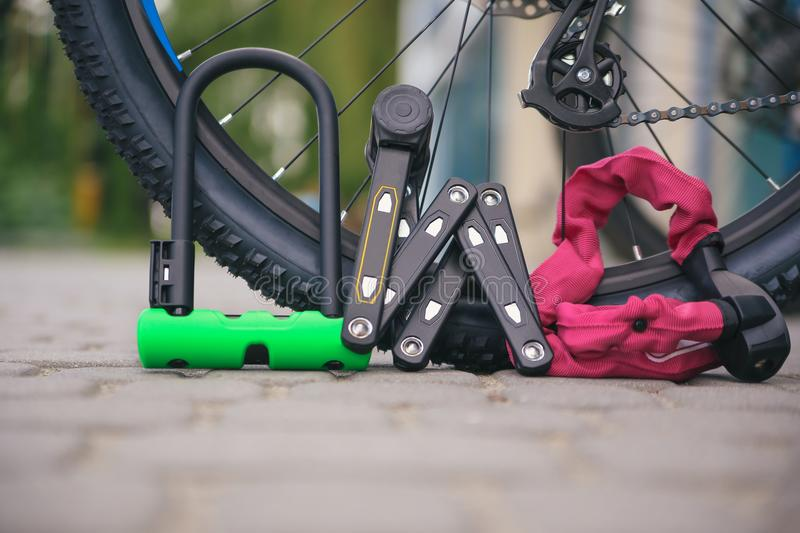 Bicycle locks near the bike. Cycling park royalty free stock photos