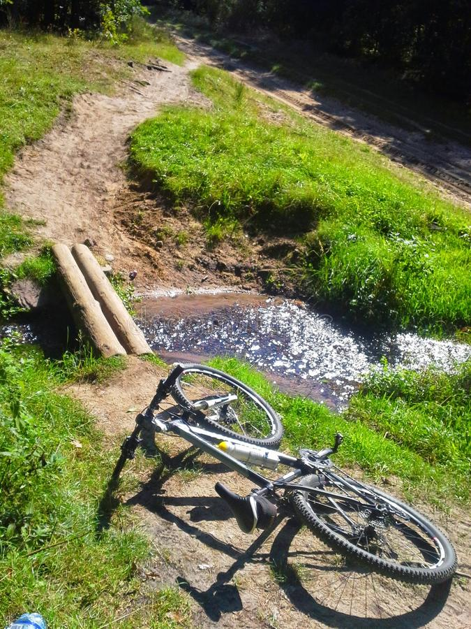 Bicycle lying on mountain path stock photo