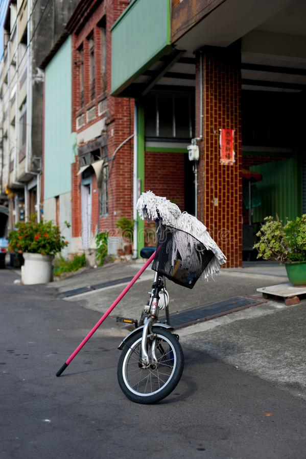 Bicycle with Mop on the street in Taipei, Taiwan. Taiwan`s wether is tropical and does not snow much during winter. In summer tim. E, international stock photos