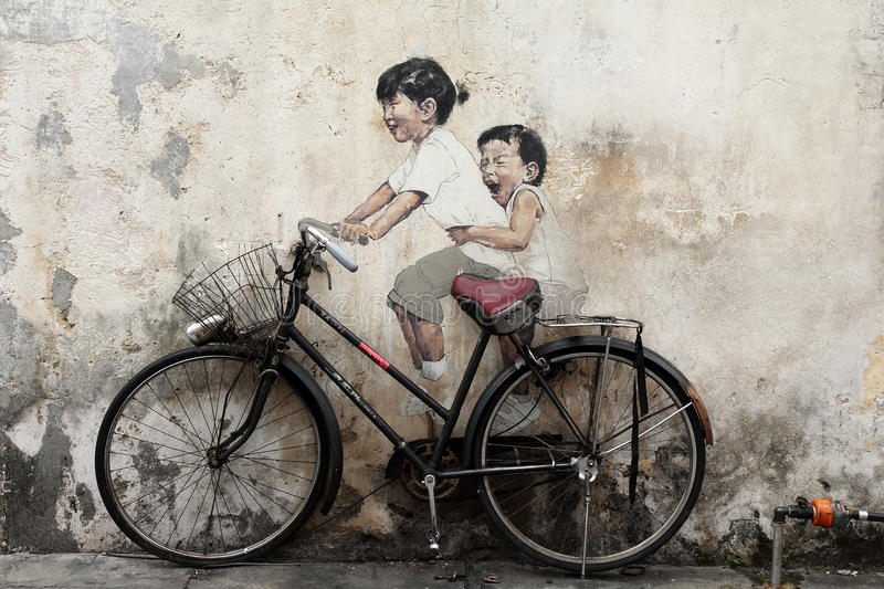 Bicycle Mural Painting at Penang. Famous Children On Bicycle mural painting at Penang, Malaysia royalty free stock images