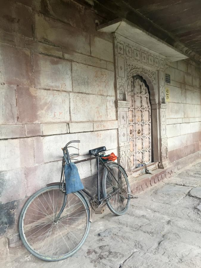 Bicycle parked on an empty street. A commuter bicycle parked on an empty street if Jodhpur royalty free stock photo