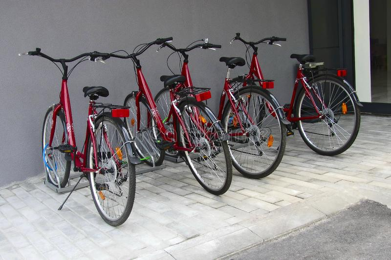 Bicycle parking near the house, urban lifestyle. Cycling through the city, transportation.Close up. Healthy lifestyle stock photo